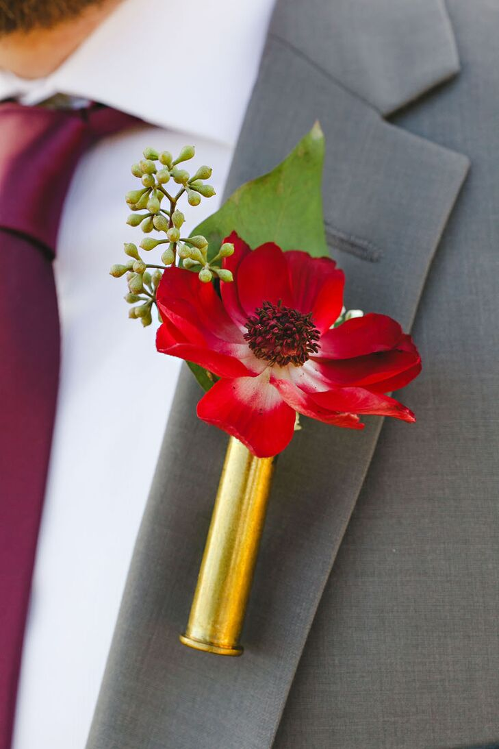 "Groomsmen wore a boutonniere with a single bloom that matched one in the bridal bouquet with a piece of greenery. ""I made the boutonniere holders from bullet casings given to us by Adam's father,"" Anika says."