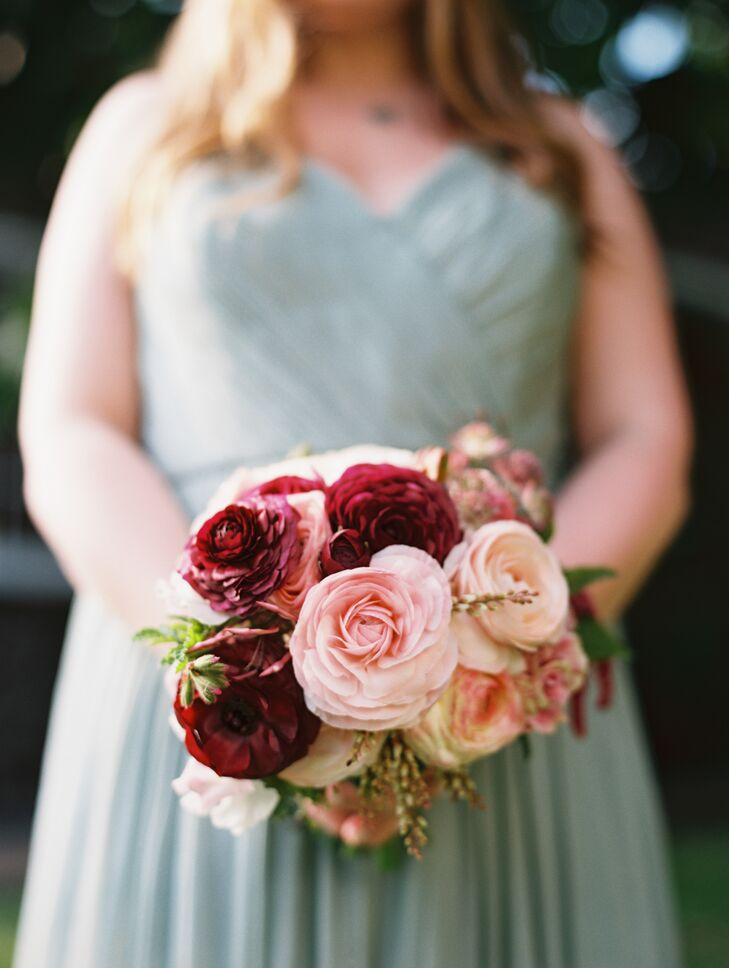 Lush bouquets of blossoming garden roses and budding plumeria brightened up the neutral sea-foam green bridesmaid dresses.