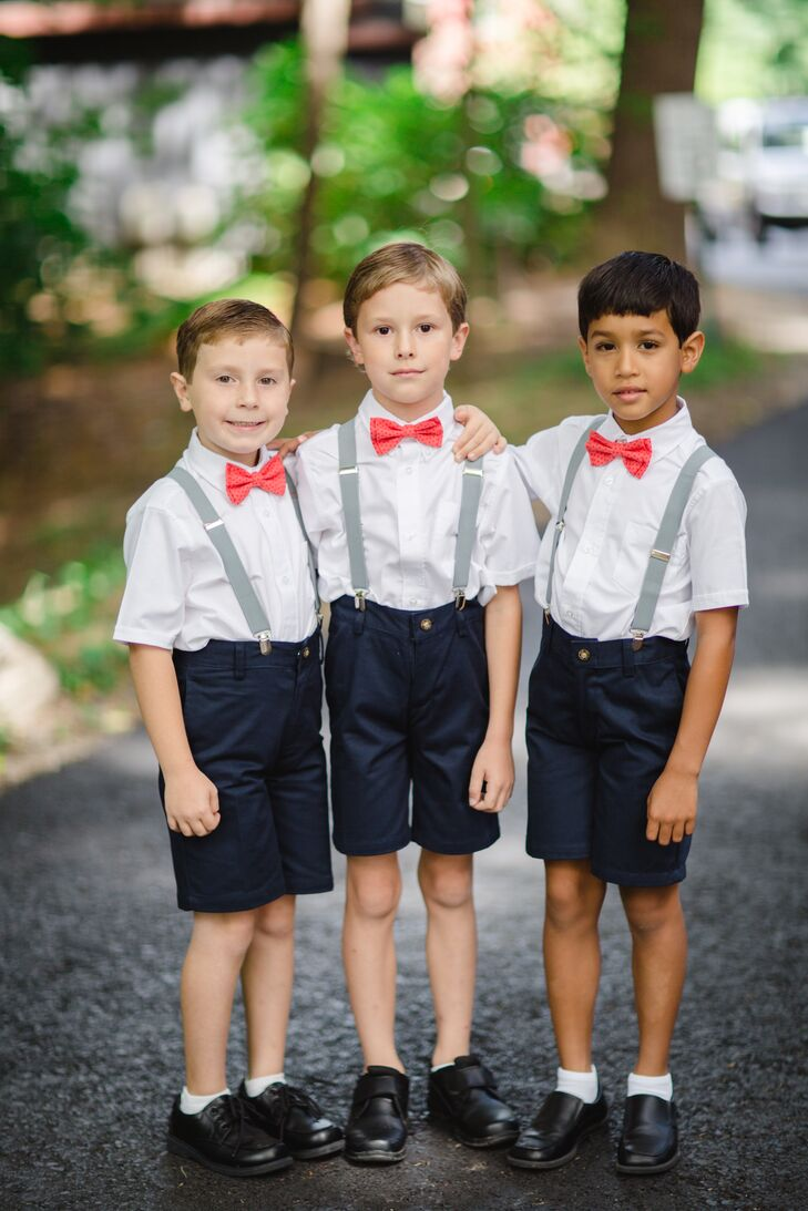 Hannah and Ed kept things elegantly casual to fit with their festive summer garden-party theme. The ring bearers looked sharp in navy shorts, white button-downs and playful accessories like coral bow ties and suspenders.