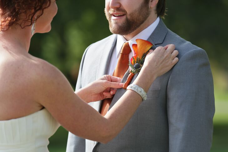 Skyler wore a orange calla lily and blue thistle wrapped with a brown ribbon on his lapel.