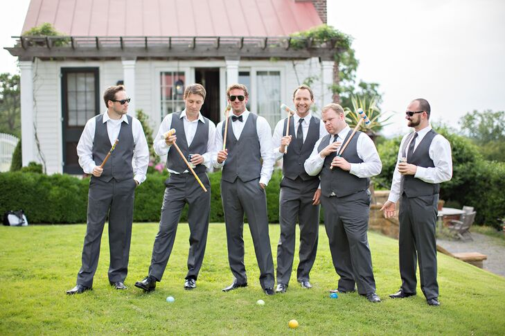 "The groom and his groomsmen wore charcoal gray suits. ""Since our wedding was outdoors we felt like wearing a tux would be too much, not to mention too hot,"" Sydney says. ""Have you ever been to Arkansas in June? Scorcher! We chose traditional ties for the groomsmen and to set Ryan apart he wore a bow tie."""