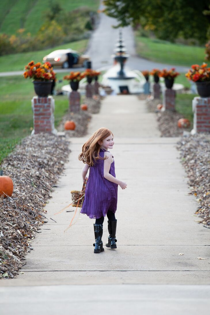 "Lindsey and Skyler told the flower girl to wear whatever she wanted as long as it was fall colored. ""She decided on a purple dress with black knee-high boots,"" Lindsey says. ""Close enough for us!"""