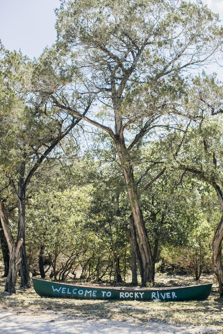 """Courtney and Mark had their wedding at a beautiful summer camp in Wimberley, Texas, called Rocky River Ranch. """"Having our wedding at a camp allowed us to invite all our family and friends to stay the weekend with us,"""" Courtney says."""