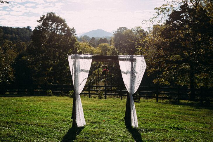 The couple exchanged vows at Yesterday Spaces, in Leicester, NC, taking advantage of the mountain setting and a beautiful barn venue.