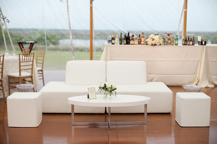 "During cocktail hour and throughout the reception, guests could kick back at the modern lounges dotting the Sperry tent. ""They were one of my favorite parts,"" says Genevieve. The sleek white furnishings and ghost chairs complemented the day's color palette while adding contemporary edge to the decor."