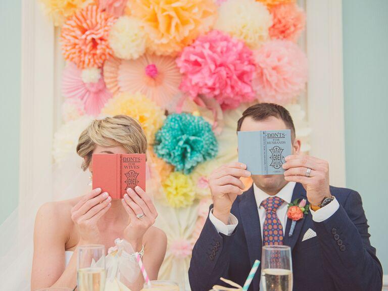 Newlyweds looking at wedding books