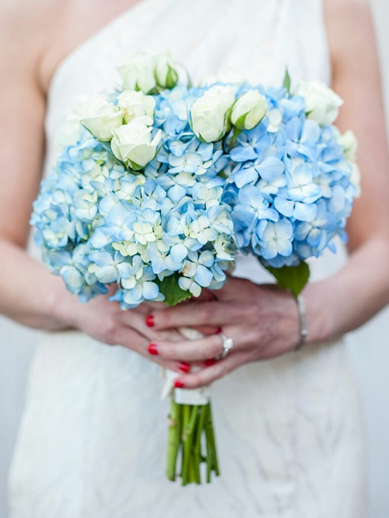 Blue and white wedding bouquet with roses and hydrangea