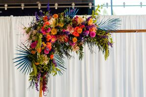 Modern Colorful Flower Arrangement with Roses, Dahlias and Painted Palm Leaves