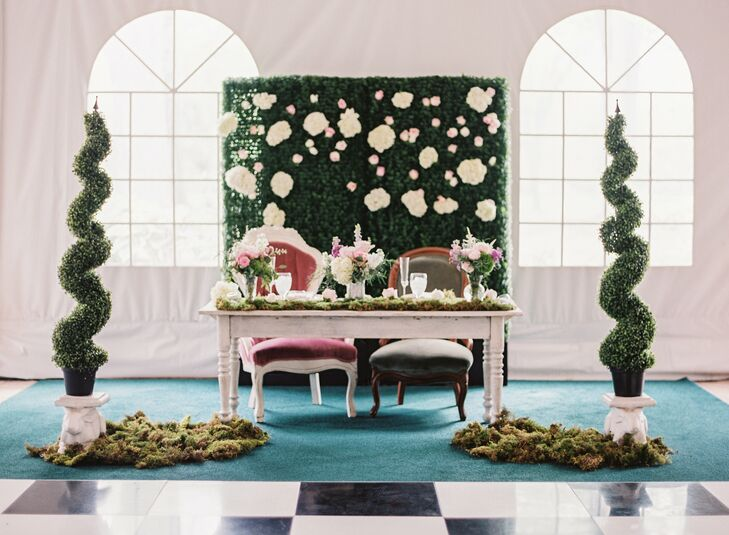 "Nicole told her wedding planner and florist that she wanted a muted theme of ""Alice's Adventures in Wonderland."" ""It was exciting to see the joy in their eyes of actually being a part of my vision and the competition it inspired in them of creating this chimerical and original wedding,"" she says. ""They knew it had to be Wonderland yet hold on to the elegance and grace of a nuptial."" During the reception, Nicole and Derek sat on vintage chairs in front of a floral wall, flanked by elaborate moss topiaries."
