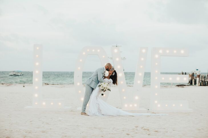 "Decor included oversize letters that spelled ""Love"" and lit up during their evening celebration at Huracan Cafe in Punta Cana, Dominican Republic."