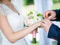 Couple exchanging rings wedding ceremony songs