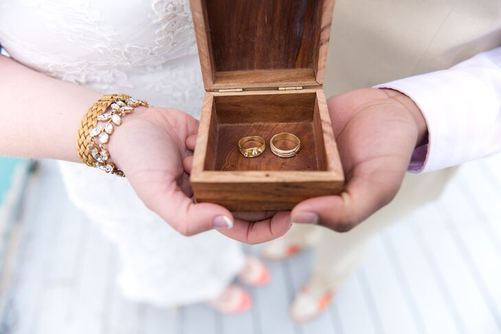 The couple chose unique gold diamond wedding bands with embellished wave details.