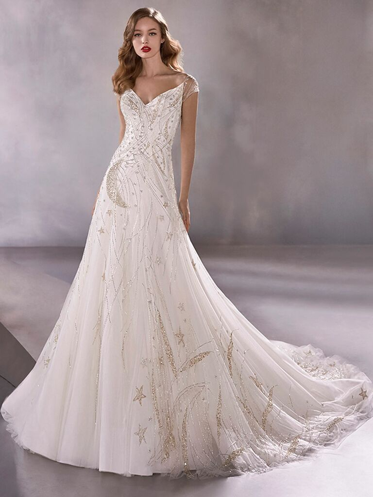 Atelier Provonias wedding dress tulle a-line gown with beaded moons and stars