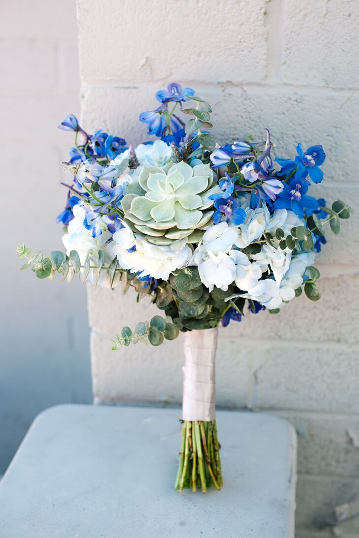 Gloria's bouquet consisted of vibrant blue delphiniums with blue and white hydrangeas, green succulents and eucalyptus.