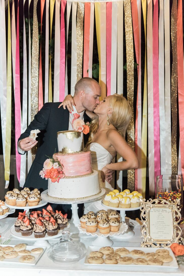 The bountiful dessert table was set against a ribbon backdrop with coral, pink, yellow and orange ribbons, a DIY project Jillian took on. For favors, guests took home candy bags containing Gummi Bears (Jillian's favorite) and M&Ms (Adam's favorite).
