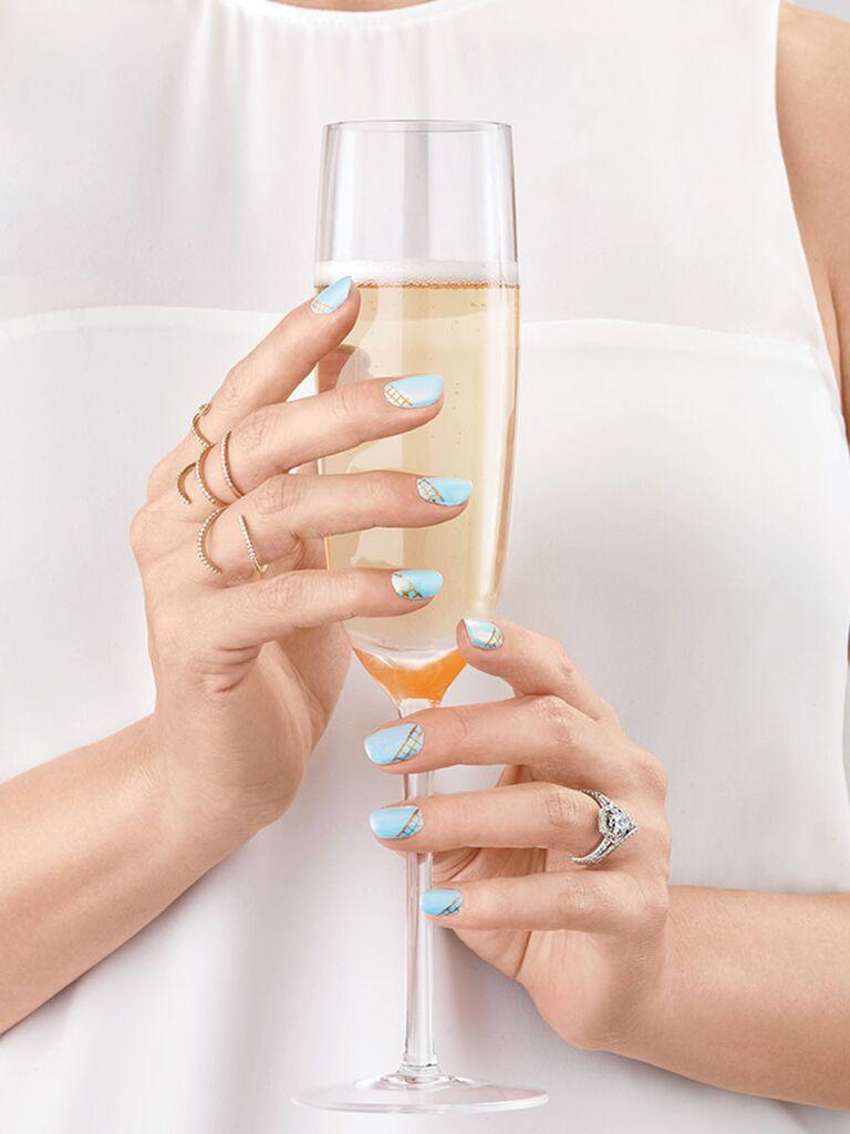 Light blue bridal nail idea by Narina Chan