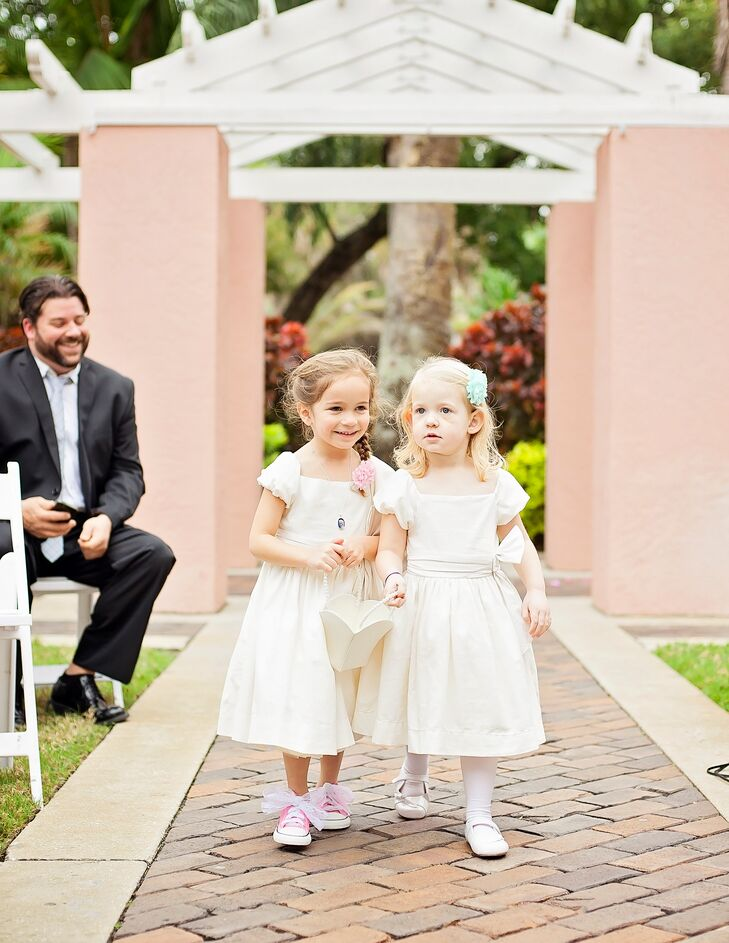 51fcad1a7737 Gina and Adam s flower girls walked down the aisle in classic ivory dresses  with cap sleeves