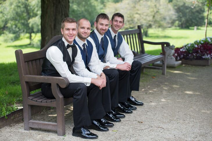 Stephen wore a black vest and a black bow tie on his wedding day. His groomsmen wore navy vests and navy ties.