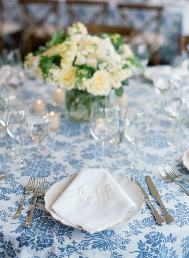 A slate and white damask tablecloth with classic white china and monogrammed napkins gave the reception tables a timeless, elegant look.