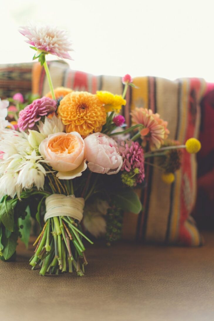 Laura carried a loose arrangement of ranunculus, peonies, dahlias, craspedia and wildflowers.