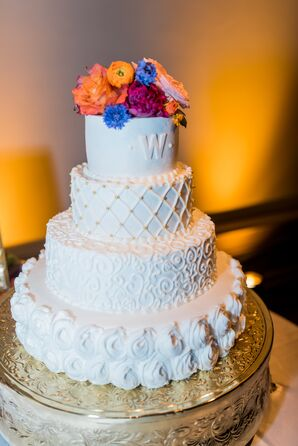 Detailed Cake with Different-Textured Tiers And Shared Initial