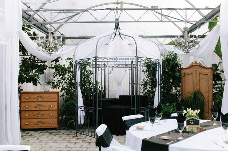 Vintage dresser drawers and a wire gazebo decorated the inside of the greenhouse reception at the Secret Garden of Woodbridge Ponds.