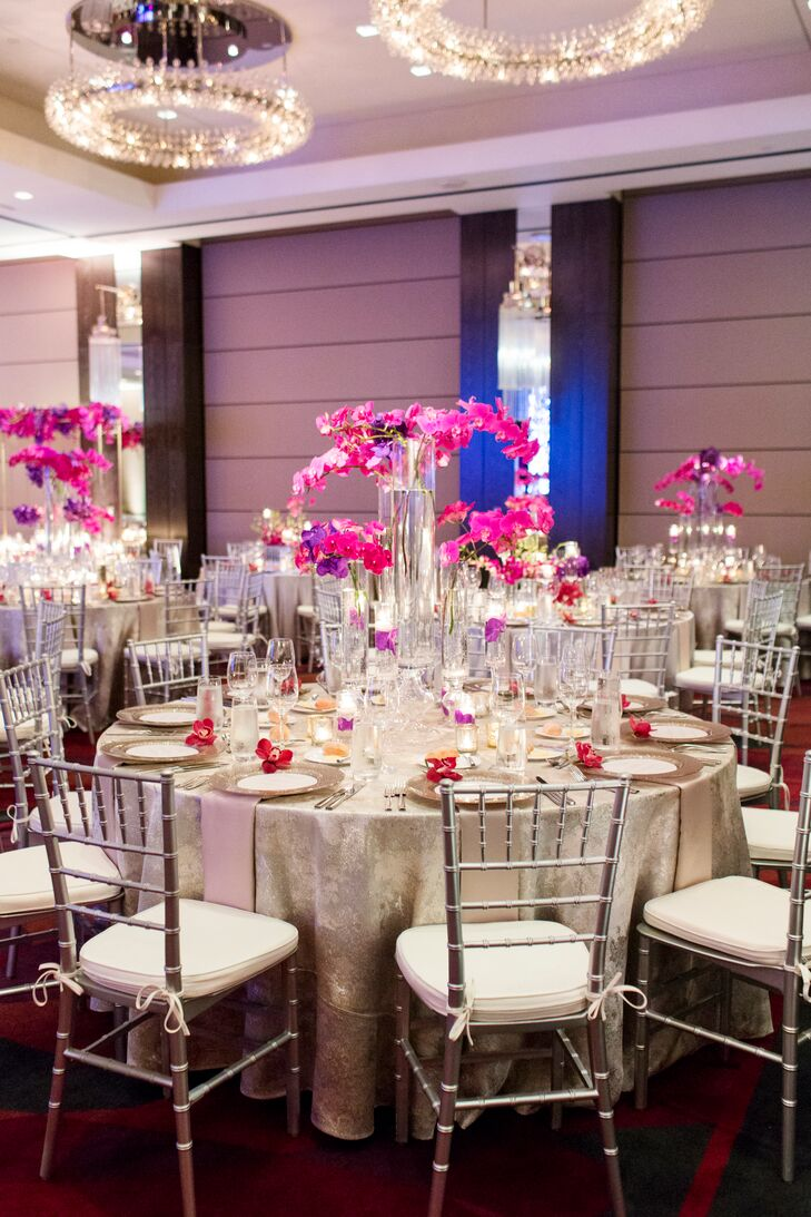 Round Reception Tabled Dressed with Metallics and Orchid Centerpieces