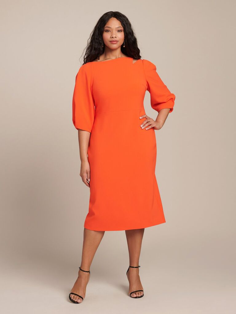Orange midi dress with asymmetrical neckline and puff sleeves