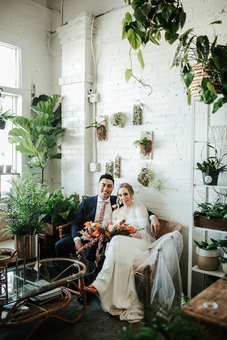 Couple Portraits on Couch at Fancy Free Nursery in Tampa, Florida
