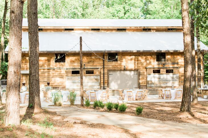 The barn was just a short walk from the ceremony site, and the outdoor space featured rustic table settings and string lights.