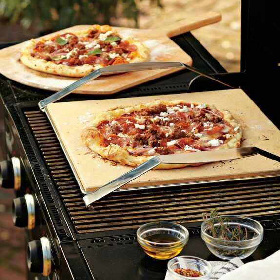 Pizza stone with pizza on a grill