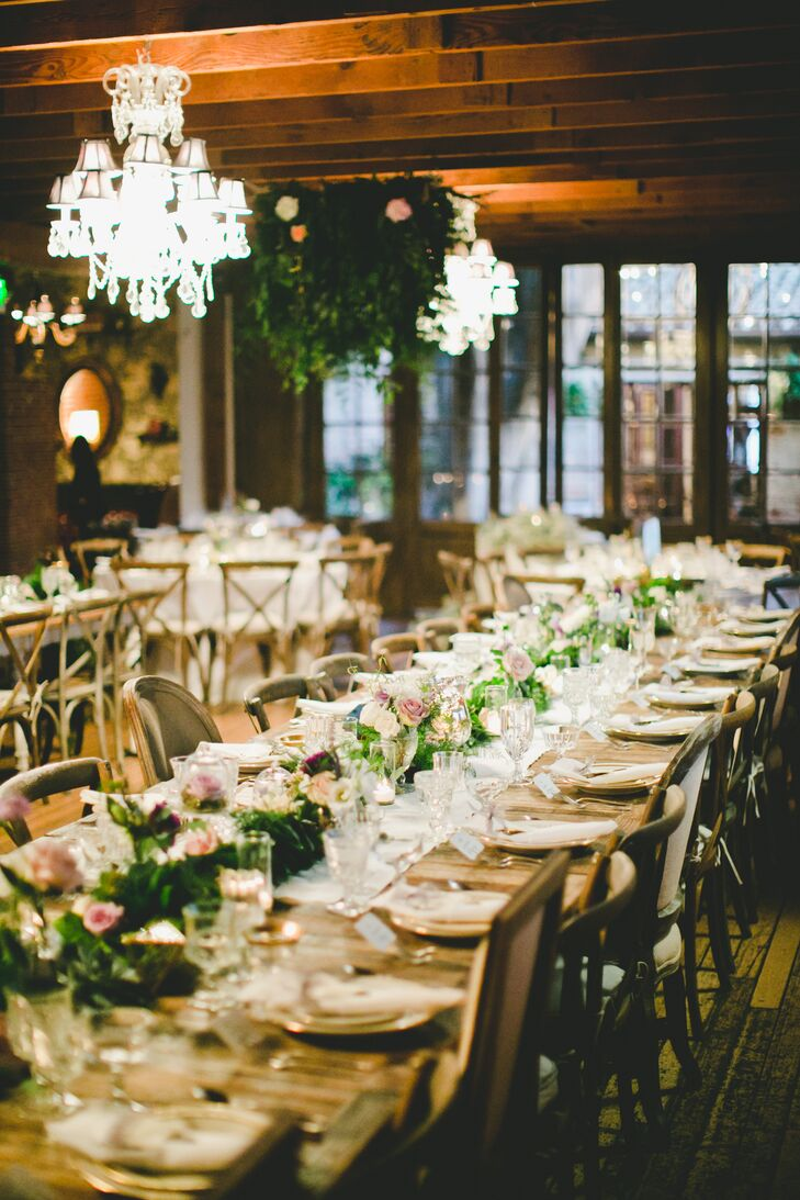 Los Angeles florist Peony and Plum decorated the tables with blooms in lavender, blush and white. Moss was set inside terrariums, apothecary jars or vintage bud vessels. Along the length of each table were lush garlands of lemon leaves, plumosa ferns and seeded eucalyptus, along with loose blooms of white and peach dahlias and champagne and peach garden roses.