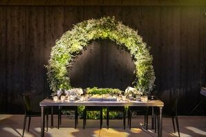 Glamorous Wood Head Table with Greenery Wreath Backdrop