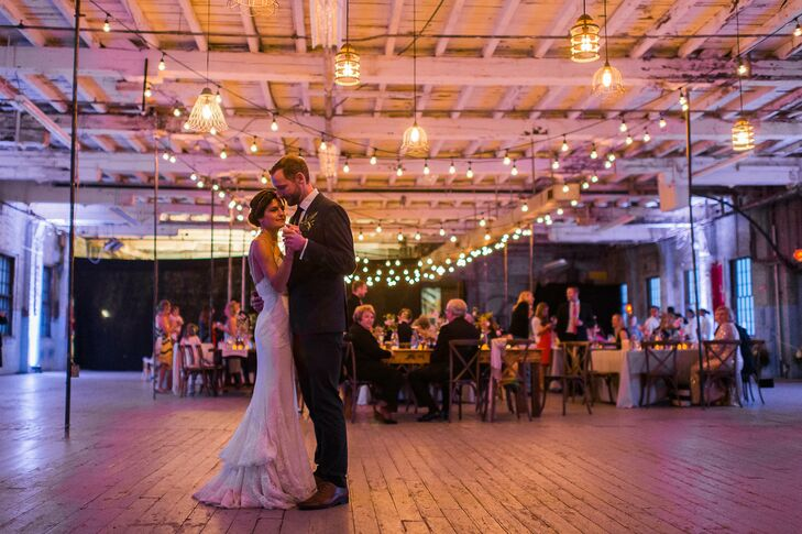 """To bring Lauren and Dave's vision for an intimate, backyard-inspired event to life, The Event Light Pros lit up the dance floor with unique drop-socket pendants. After cocktail hour and dinner, the couple kicked off an evening of celebrating with their first dance to Kenny Chesney and Grace Potter's """"You and Tequila."""" DJ Luke Lanigan took it from there, getting guests up out of their seats and out on the dance floor. """"He was awesome and listened to my every request,"""" says Lauren. """"Music was definitely something we were picky about and wanted it to really set the mood for the evening. He had everyone dancing the whole night through!"""""""