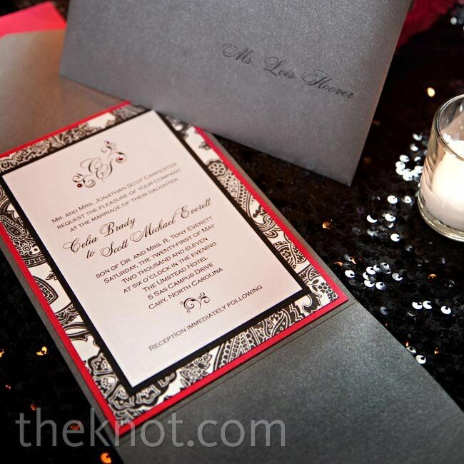 The sophisticated invitations featured a black-and-white paisley border with pink lining.