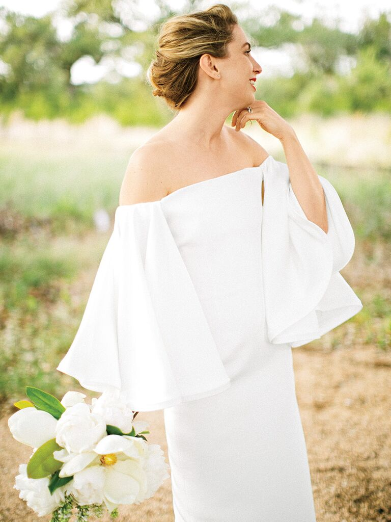off-the-shoulder wedding dress with statement sleeves