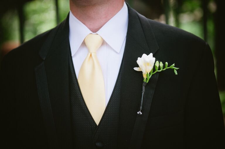 Simple white freesia boutonniere