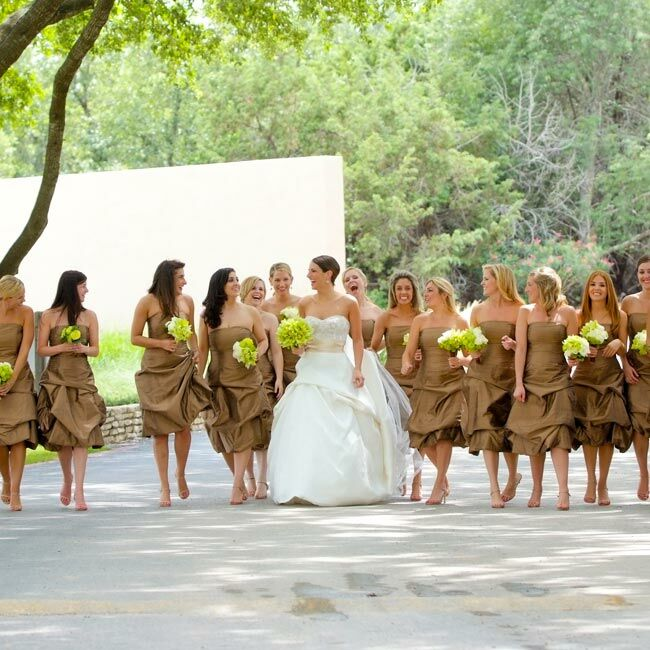 Andrea's 12 bridesmaids -- yes 12! -- and four cousins all wore custom-made silk dupioni dresses with bubble skirts.