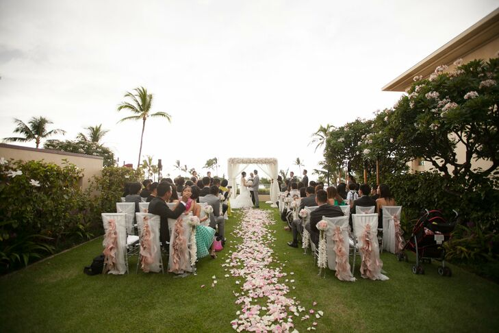 The couple exchanged vows in a romantic outdoor ceremony on the island of Maui in Hawaii. The aisle was lined with loose rose petals.