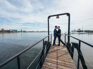 This modern, sophisticated wedding took place at Hotel Maya in Long Beach, California, which embodied a subtle Latin flair that reflected the grooms'