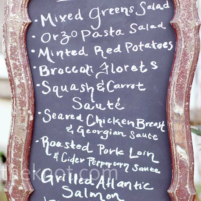 A vintage frame held a chalkboard with the handwritten menu for the reception meal for all guests to see.