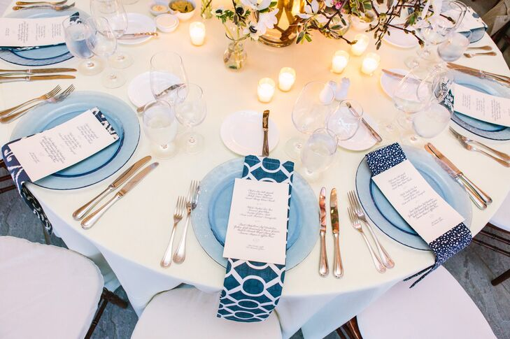 To give their tables a distinct look, Danielle and Patrick tapped into Danielle's mother's fabric design connections to source blue-and-white-patterned fabrics in more than 10 variations straight from vendors and factories. The fabric was then made into napkins and placed in random fashion on tables throughout the reception tent to stunning effect.