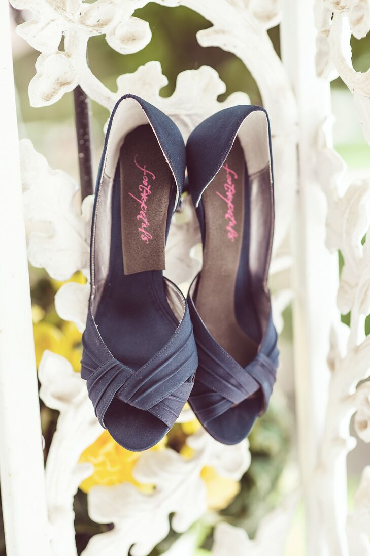The bride's satin shoes matched the navy hue of her bridesmaids' Watters dresses.