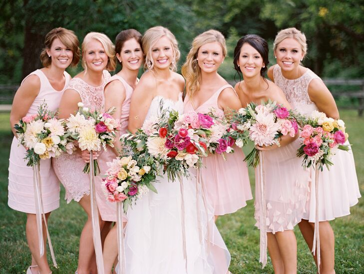 To keep things feeling casual, yet still elegant and ethereal, Kristina had her six bridesmaids choose their own dresses, each in a soft shade of pale pink or peach.