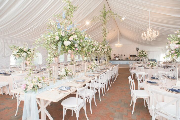 Tented Reception with Draping, Chandeliers, White Tables and Chairs, and Pastel Flower Arrangements