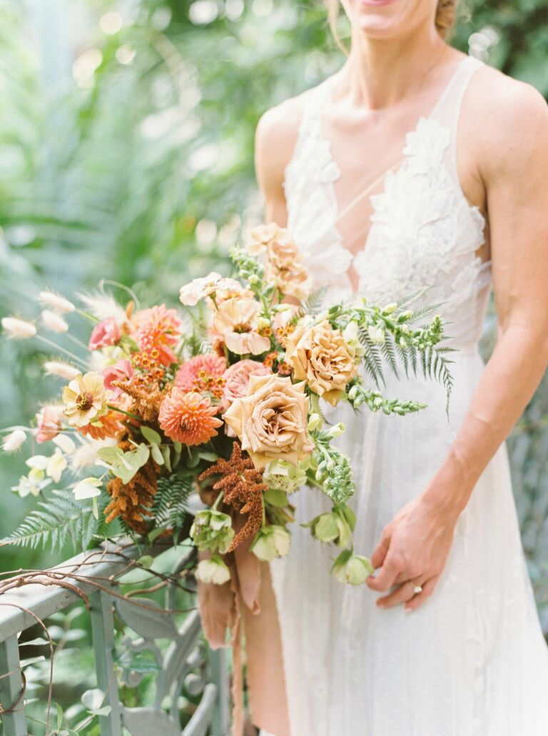 Peach wedding bouquet with dahlias and roses