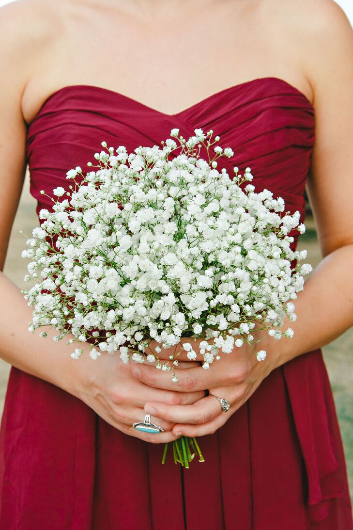 "Decked in burgundy dresses, Anika opted for a downplayed bouquet of baby's breath for her bridesmaids. ""The small, cloudlike white buds stood out beautifully against the dark contrast of their dresses."""