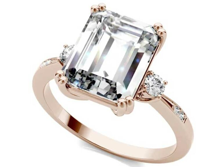 Emerald-cut moissanite solitaire engagement ring with side accents on rose gold band