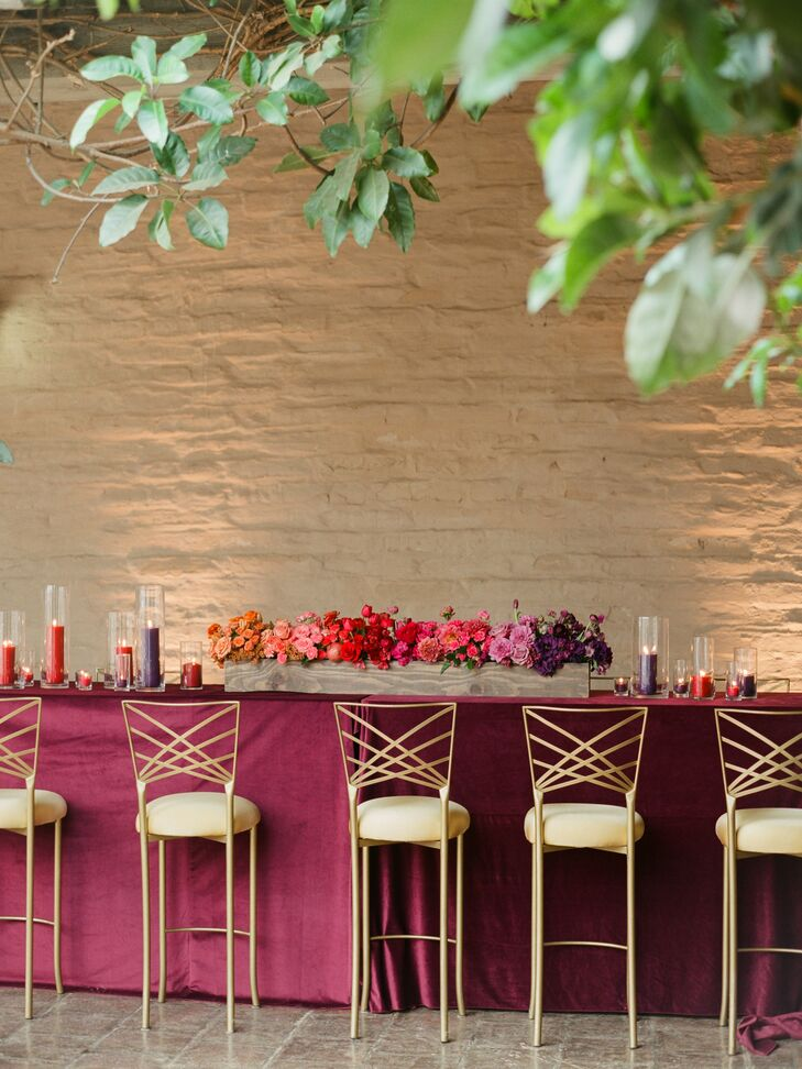 Dining Table with Fuchsia Linen and Gold Chairs