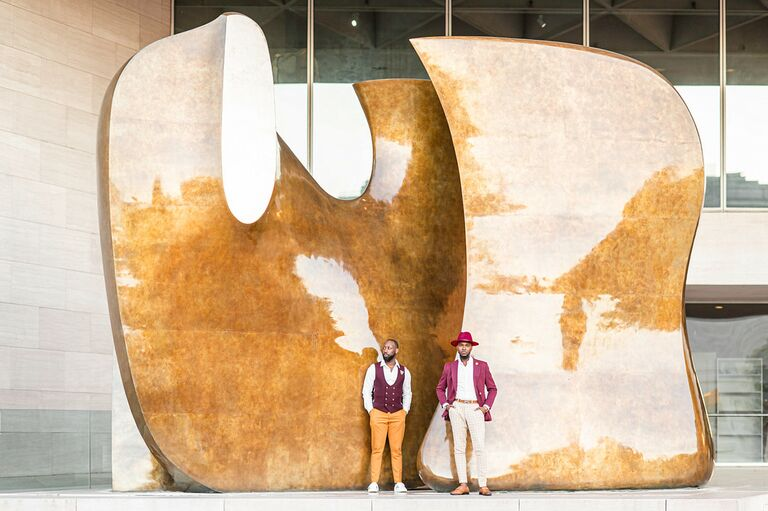 Couple poses in front of art installation
